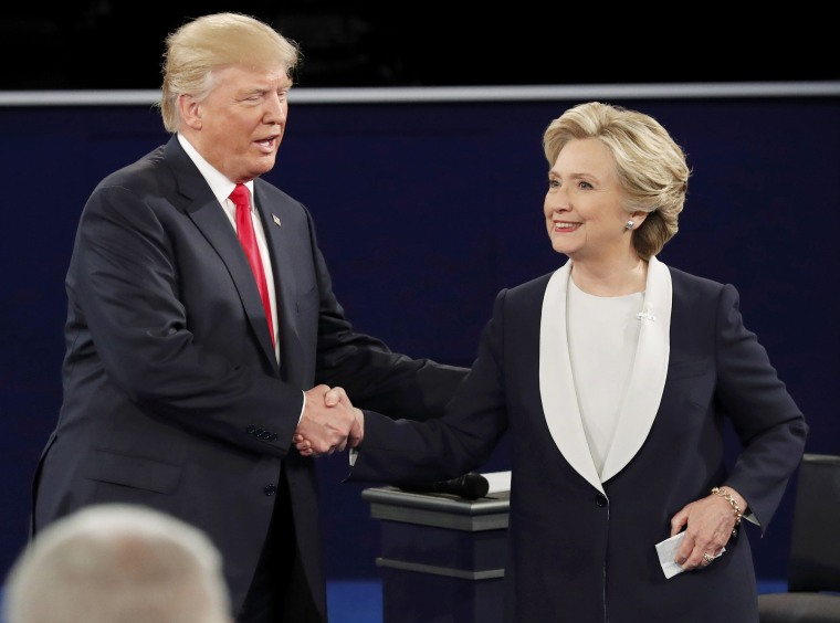 Image: Republican U.S. presidential nominee Donald Trump and Democratic U.S. presidential nominee Hillary Clinton shake hands at the end of their presidential town hall debate at Washington University in St. Louis