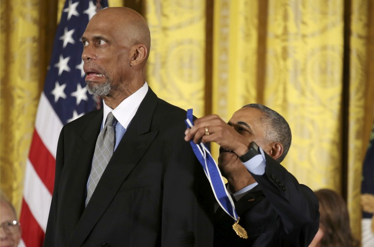 Image: President Obama put medal on NBA staar Kareem Abdul-Jabbar at Presidential Medal of Freedom ceremony at White House in Washington