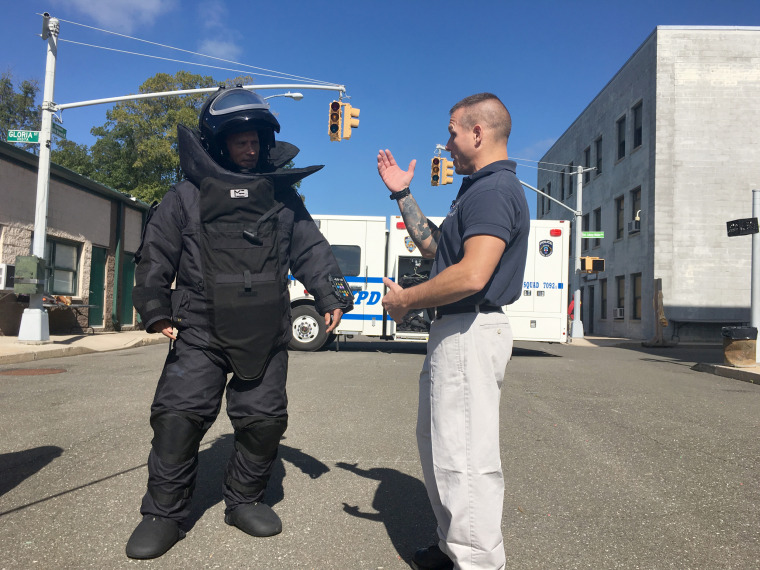 Lester Holt of NBC News (left, in bomb suit) with Det. Jason Hallik of the NYPD bomb squad.