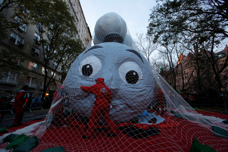 Image: A volunteer helps inflate the Thomas the Tank  Engine balloon ahead of the 90th Macy's Thanksgiving Day Parade in Manhattan, New York, U.S.