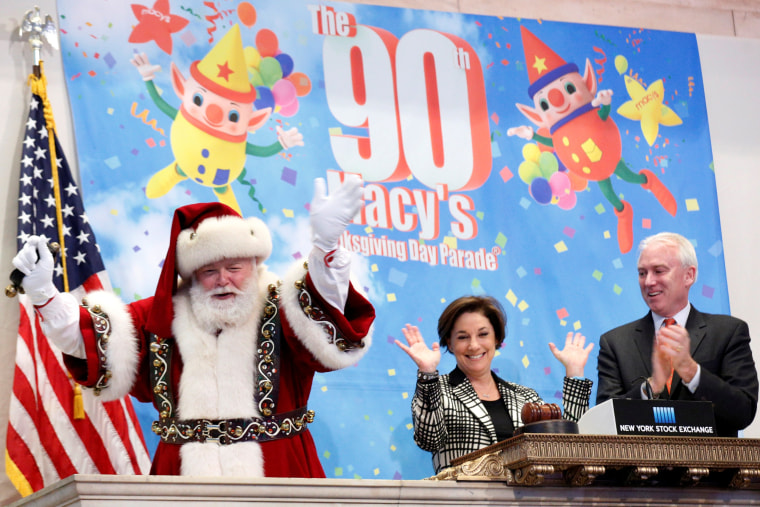 Image: Santa Claus rings the opening bell in celebration of the Macy's 90th Annual Thanksgiving Day Parade at the NYSE