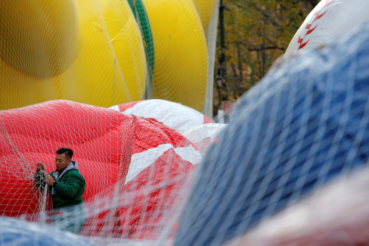 Image: A member of the Macy's Inflation Team works on the Red Mighty Morphin Power Ranger balloon ahead of the 90th Macy's Thanksgiving Day Parade in Manhattan, New York, U.S.