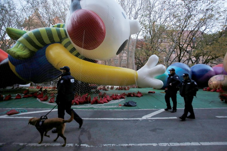 Image: Members of the New York Police Department's Counterterrorism Bureau patrol the inflation area ahead of the 90th Macy's Thanksgiving Day Parade in Manhattan