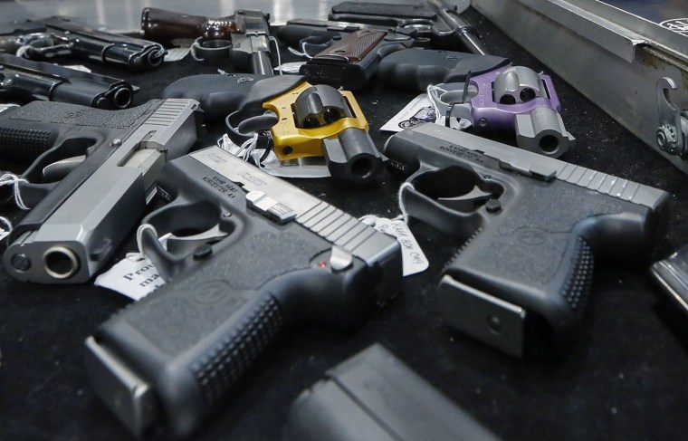 In this Saturday, Jan. 26, 2013 file photo, handguns are displayed on a vendor's table at an annual gun show in Albany, N.Y.