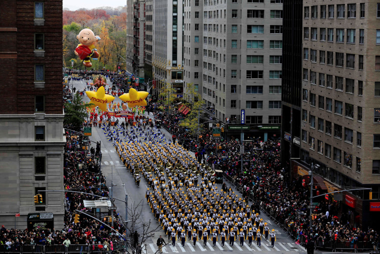 Image: A marching band makes its way down 6th Avenue during the 90th Macy's Thanksgiving Day Parade in the Manhattan borough of New York