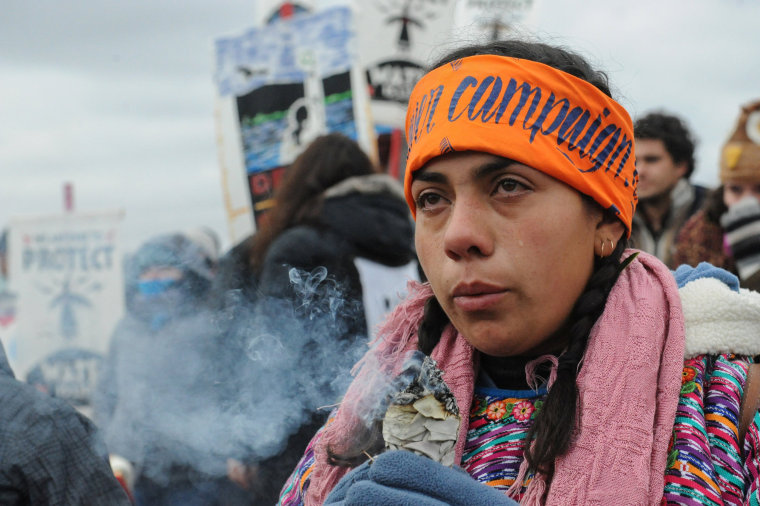 Image: A protester cries while watching a demonstration on Turtle Island on Thanksgiving day during a protest against plans to pass the Dakota Access pipeline near the Standing Rock Indian Reservation, near Cannon Ball, North Dakota, U.S.