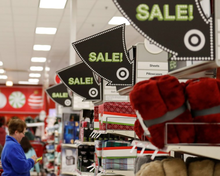 Image: Signs point to the sale items during the Black Friday sales event on Thanksgiving Day at Target in Chicago