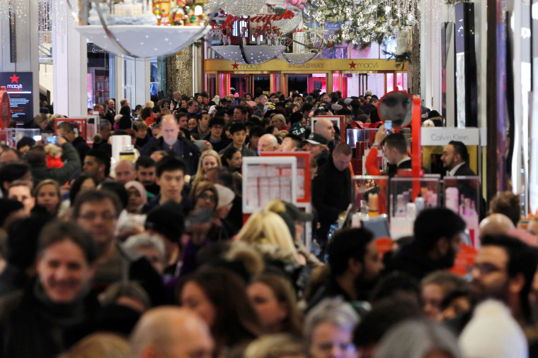 Image: People walk through Macy's Herald Square store during early opening for Black Friday sales in Manhattan, New York