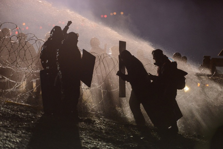 Image: Police use a water cannon on protesters near the Standing Rock Indian Reservation