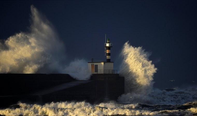 Image: Huge waves crash on the San Esteban de Pravia seafront in the northern Spanish region of Asturias