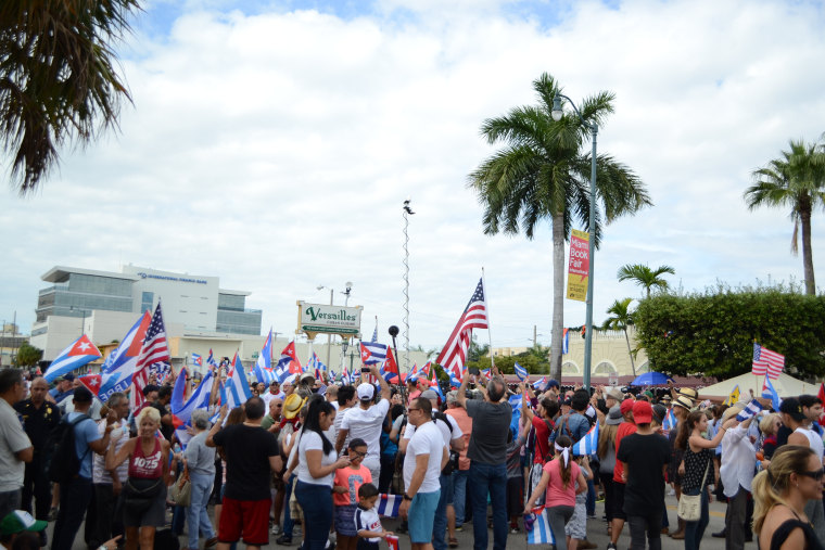 Cuban Americans gather in front of Versailles Restaurant in Miami following news of Fidel Castro's death.