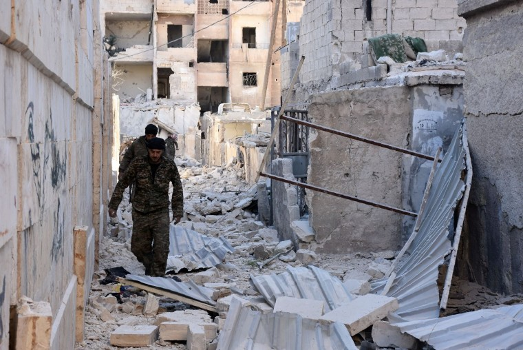 Image: Syrian pro-government forces in Aleppo