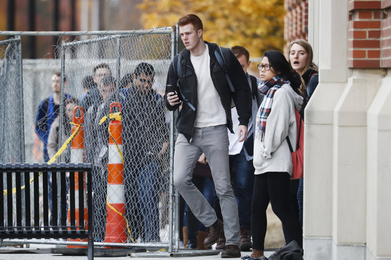 Image: Students leave buildings as police respond to an attack on campus at Ohio State University