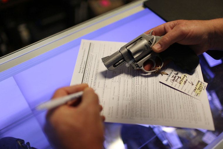 Image: A client fills out his Federal background check paperwork