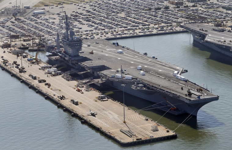 The nuclear powered aircraft carrier USS Dwight D. Eisenhower sits pier side at Naval Station Norfolk in Norfolk, Virginia,  April 27.