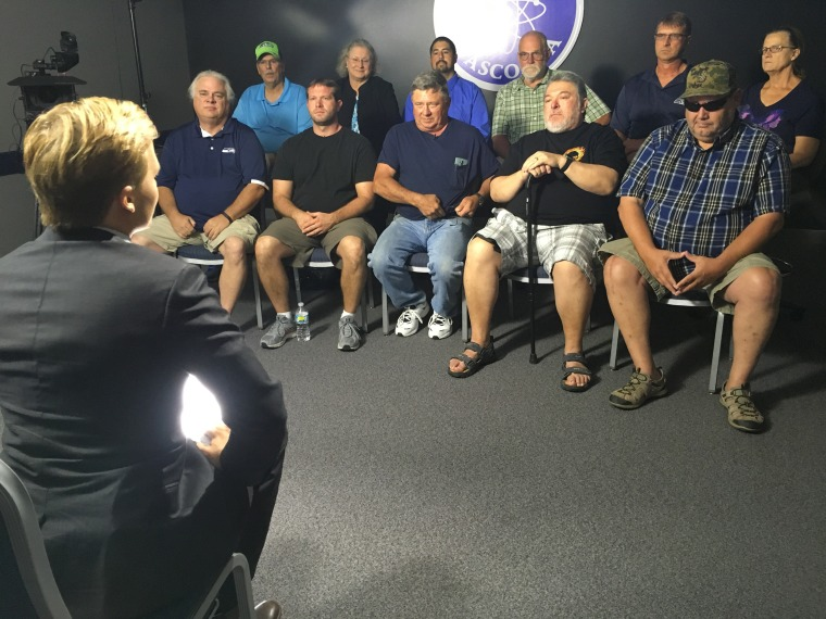 Ronan Farrow with current and former workers from the Hanford Nuclear Site.