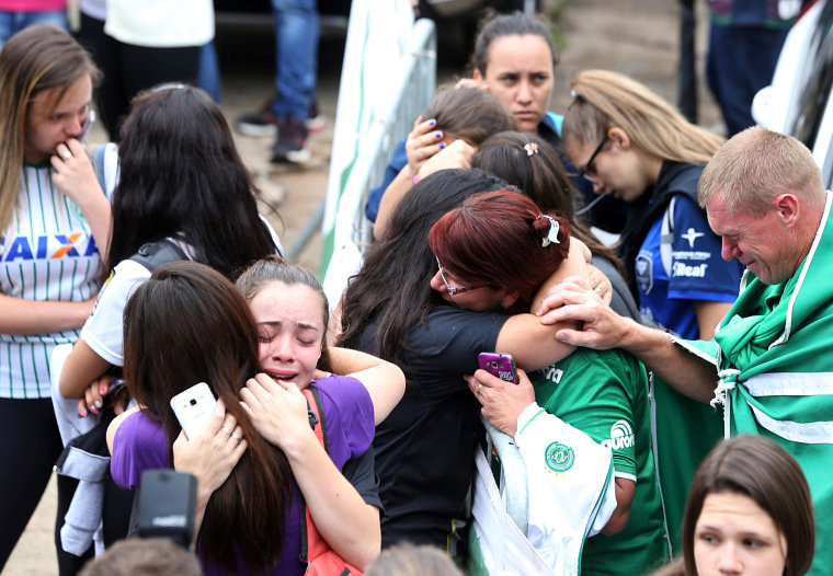 Image: Fans of Chapecoense soccer team react in front of the Arena Conda stadium in Chapeco