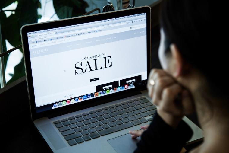 Image: A woman online shopping at online fashion retailer Reebonz