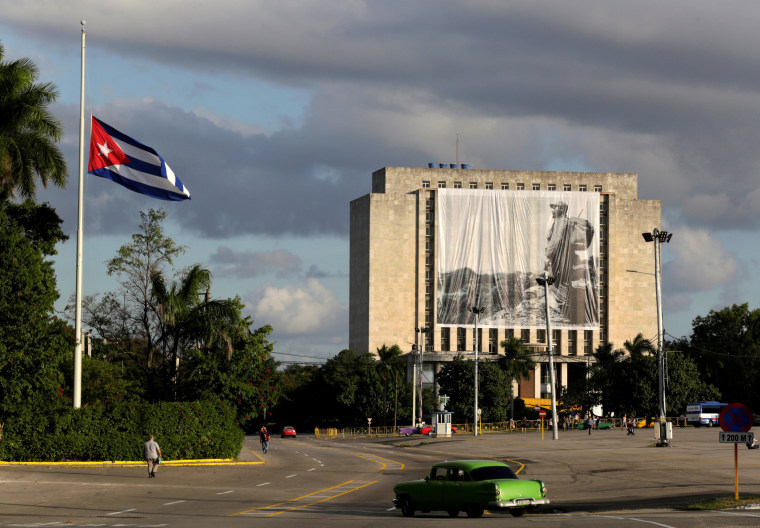 Image: A picture of Cuban former president Fidel Castro hangs in front of the Cuban National Library at Revolution Square in Havana