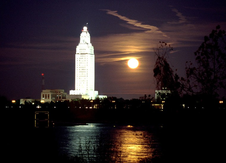 Full moon next to State Capitol Bldg. ad