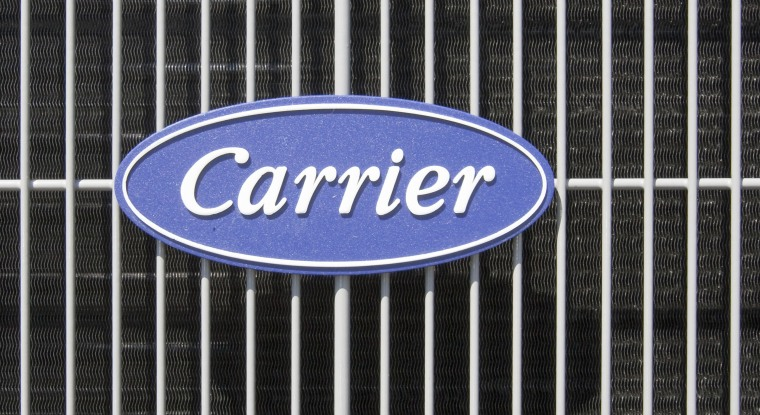 In this file photo taken April 21, 2009, an air conditioner bears the Carrier logo in Omaha, Neb. Carrier Corp. said Tuesday, March22, 2011, it has agreed to sell its unit that makes air conditioners for buses in the United States and Canada to Mobile Climate Control.