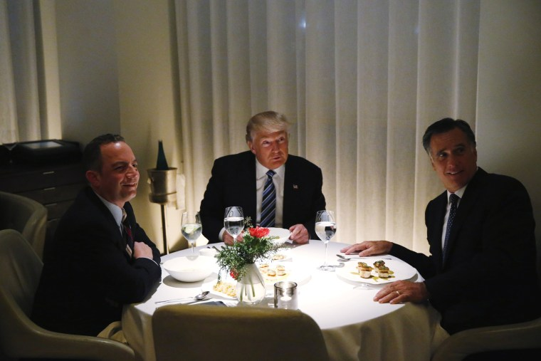 Image: U.S. President-elect Trump sits at a table for dinner with former Massachusetts Governor Romney and his choice for White House Chief of Staff Priebus at Jean-Georges at the  Trump International Hotel & Tower in New York