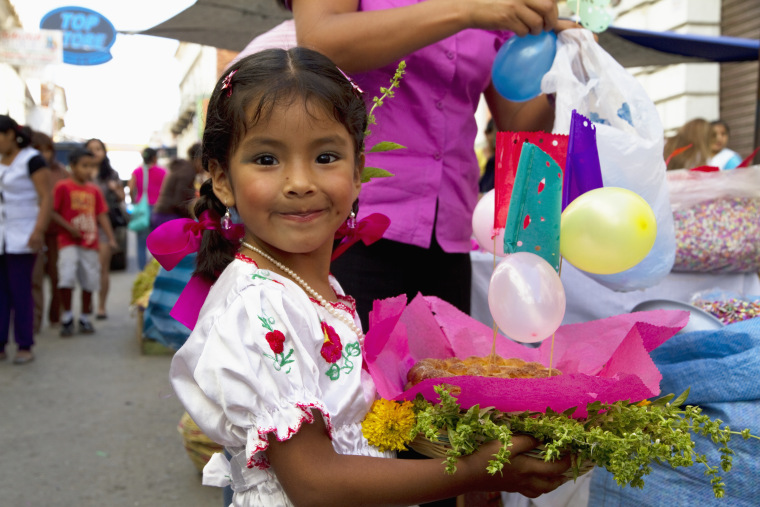 Girl Carrying A Gift Basket