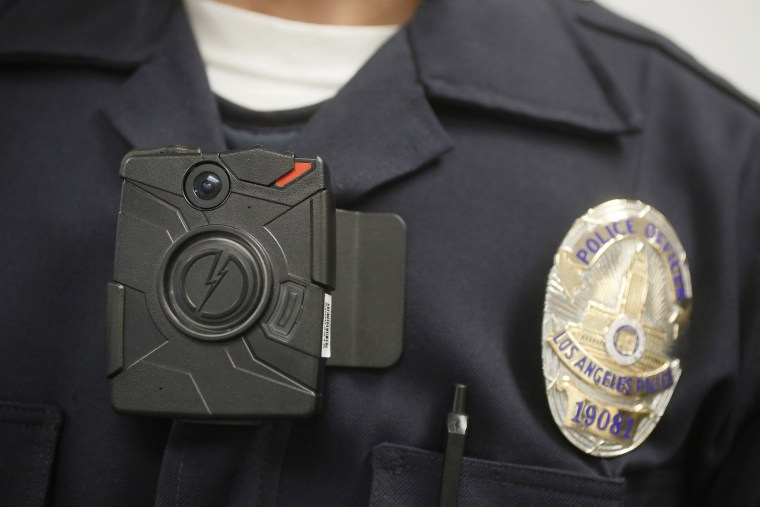 A police officer wears an on-body camera during a demonstration in Los Angeles