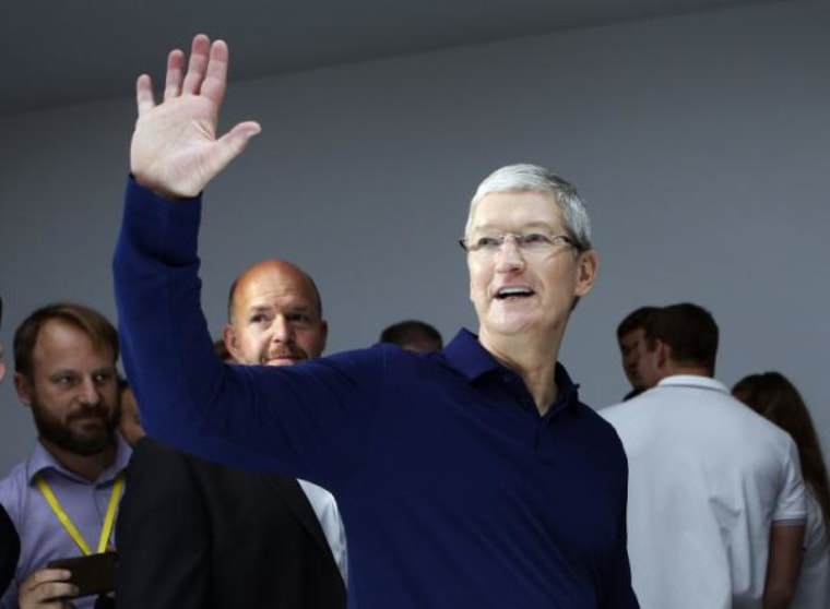 Tim Cook waves during an Apple media event in San Francisco