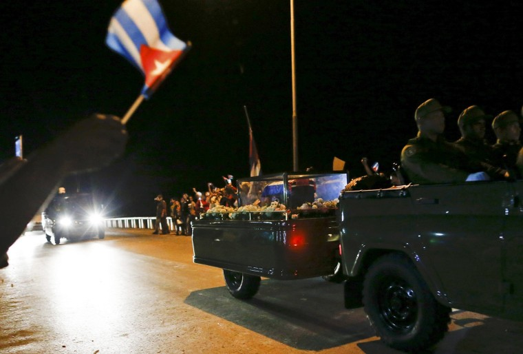 Image: The caravan carrying the ashes of Fidel Castro passes along a street in Ranchuelo