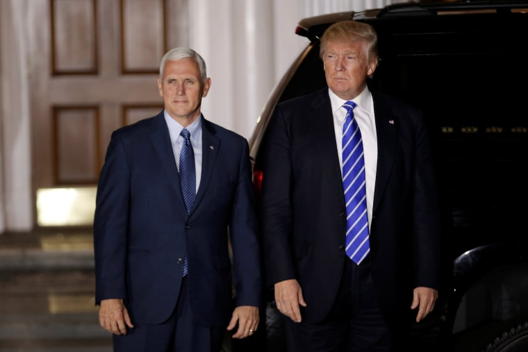 Image: U.S. President-elect Donald Trump and Vice President-elect Mike Pence depart the main clubhouse at Trump National Golf Club in Bedminster