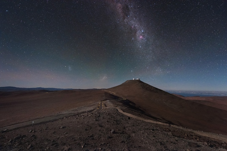 The Milky Way hangs over the European Southern Observatory's Very Large Telescope in Chile in an image released on Nov. 15. The tiny silver shapes on the distant Cerro Paranal mountain are the VLT's Unit Telescopes and smaller Auxiliary Telescopes. This image is taken from the nearby mountain that is home to another of ESO's facilities.