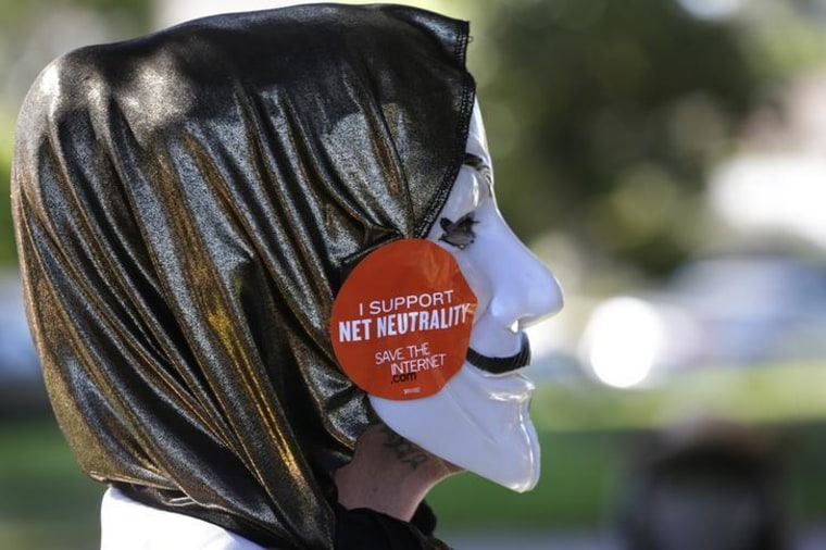 A pro-net neutrality Internet activist attends a rally in the neighborhood where U.S. Barack Obama attended a fundraiser in Los Angeles