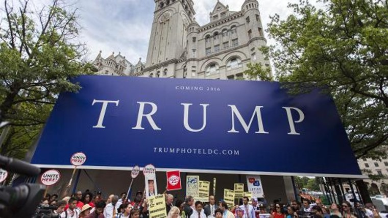 People gather in front of the under construction Trump Hotel to protest Donald Trump. Samuel Corum | Anadolu Agency | Getty Images