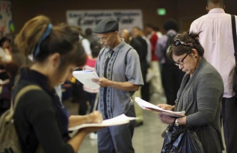 Job seekers fill out applications during 11th annual Skid Row Career Fair the Los Angeles Mission in Los Angeles
