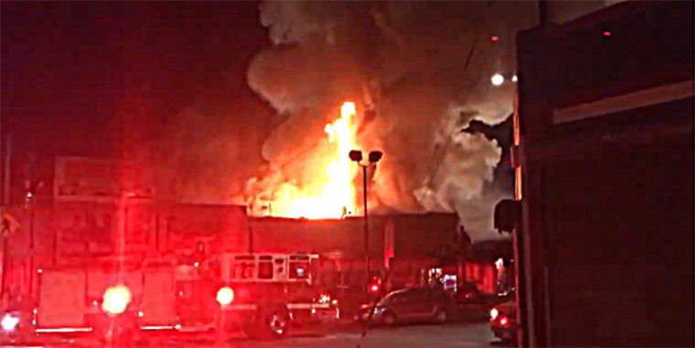 A warehouse fire burns late on Dec. 2 in Oakland, California.