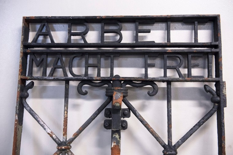 "Image: An iron gate from Dachau concentration camp in Germany with the ""Arbeit macht frei"" (work sets you free) slogan is pictured after it was found two years after it had been stolen, in Bergen"