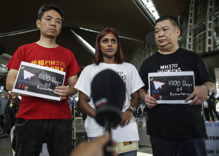Image: MH370 relatives Grace Subathirai Nathan of Malaysia stands between and Jiang Hui (left) and Bai Shuan Fu (right) from China at Kuala Lumpur International Airport before their trip to Magadascar.