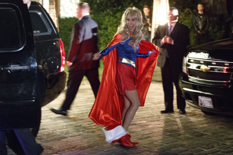 Image: Kellyanne Conway, campaign manager for Donald Trump, smiles Saturday night as she arrives for a party dressed as Super Woman.