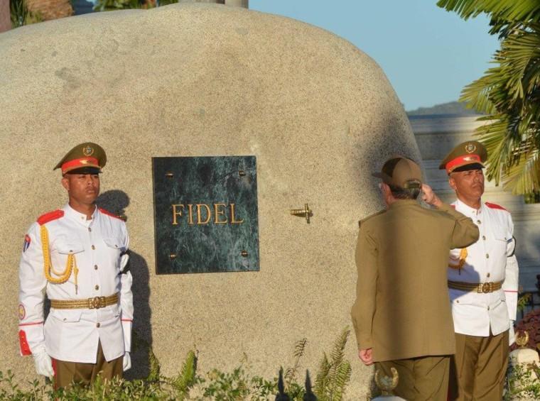 Image: Cuba's President Raul Castro places the box containing the ashes of Cuba's former President Fidel Castro into a boulder at the Santa Ifigenia Cemetery, in Santiago de Cuba