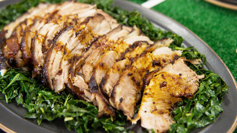 Feed a hungry crowd with easy orange pork roast and garlicky collard greens