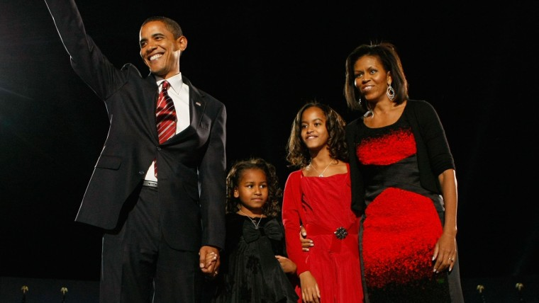 Image of Barack Obama with his family on 2008 Election Night gathering in Chicago