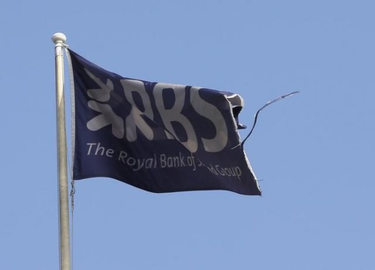 A flag flies above the head office of RBS in St Andrew Square in Edinburgh