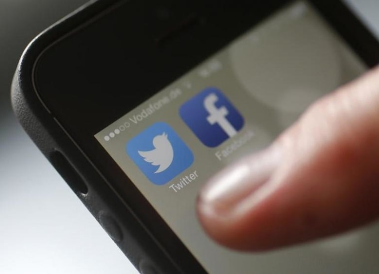 An illustration picture shows a man starting his Twitter App on a mobile device in Hanau near Frankfurt