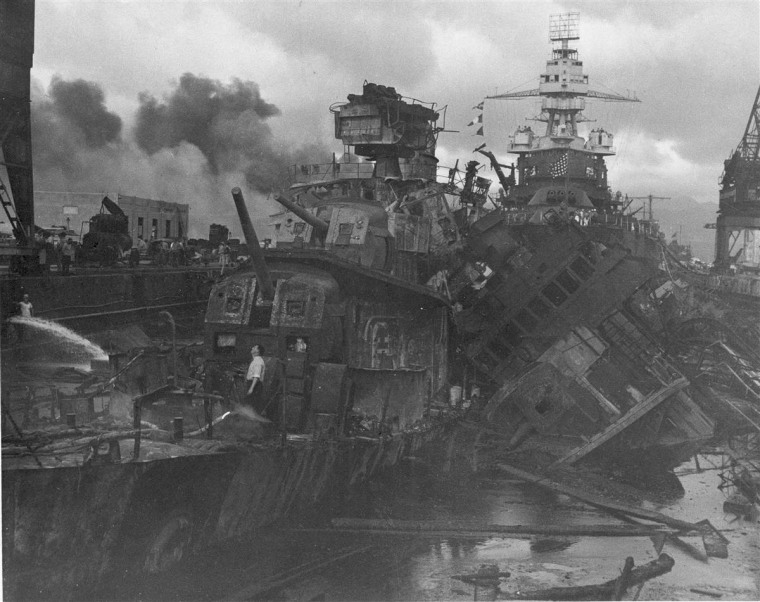 Image: Heavy damage is seen on the destroyers USS Downes (DD-375) and USS Cassin (DD-372).