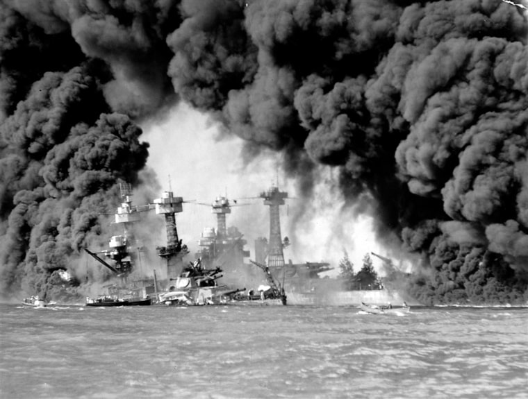 Image: Smoke pours from wrecked American warships.