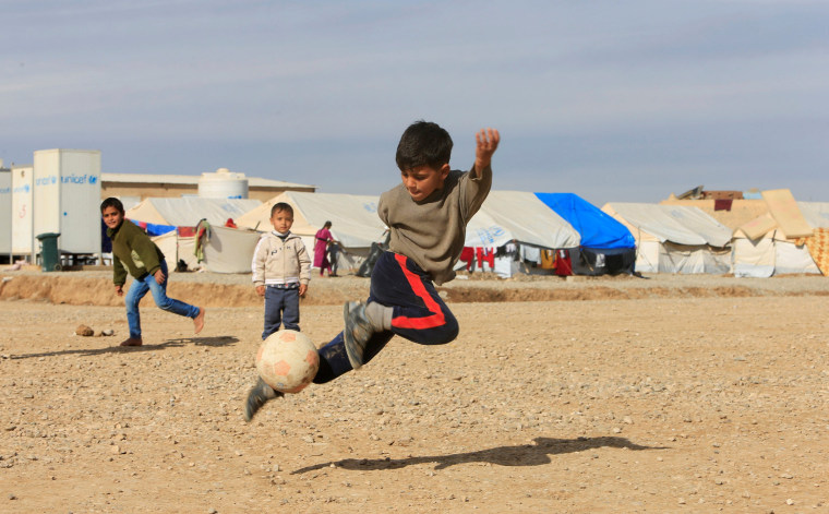 Image: Displaced Iraqi children, who fled the Islamic State stronghold of Mosul, play at Khazer camp