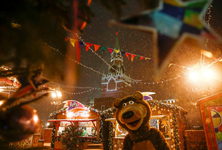 Image: A street performer dressed as a bear is seen at a Christmas and New Year market at the Red Square in Moscow