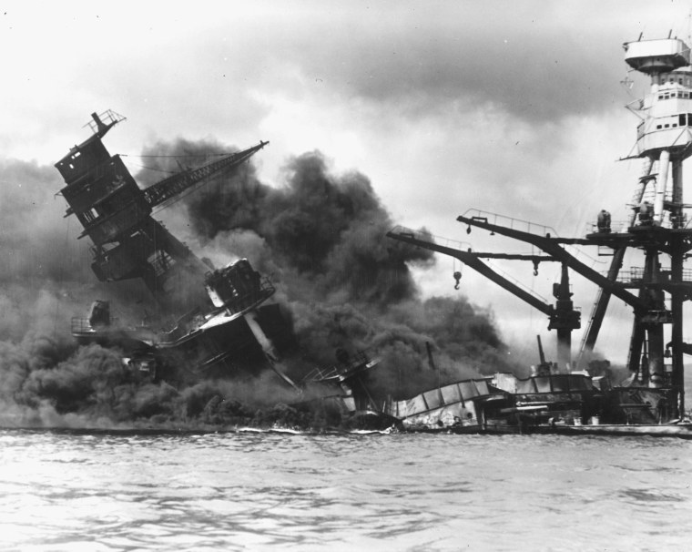 Image: The battleship USS Arizona sinks after being hit by a Japanese air attack on Pearl Harbor