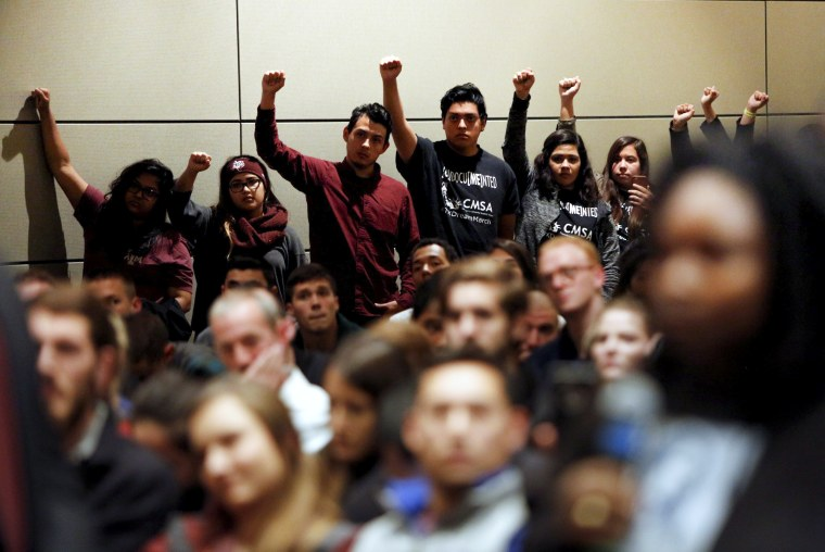 Image: Undocumented Texas A&M students and their supporters protest white nationalist leader Richard Spencer of the National Policy Institute speaks on campus on Dec. 6, 2016.
